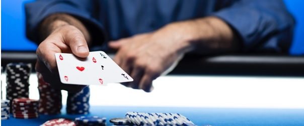 What are the 'stages' of a hand in Texas Hold'em?